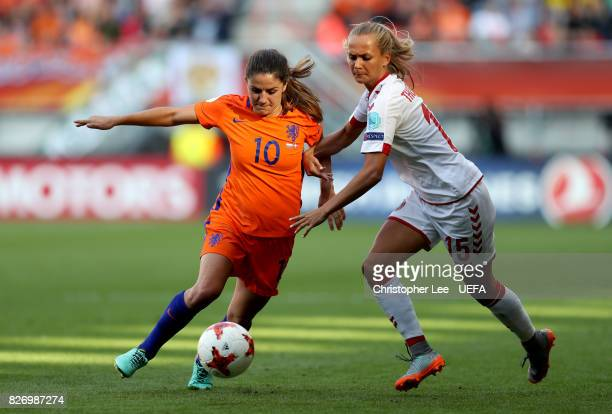 Danielle van de Donk of the Netherlands holds off pressure from Frederikke Thogersen of Denmark during the Final of the UEFA Women's Euro 2017...