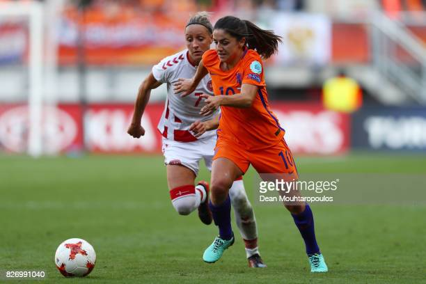 Danielle van de Donk of the Netherlands holds off pressure from Sanne Troelsgaard Nielsen of Denmark during the Final of the UEFA Women's Euro 2017...