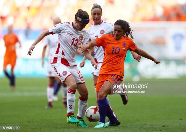 Danielle van de Donk of the Netherlands passes under pressure from Sofie Junge Pedersen of Denmark during the Final of the UEFA Women's Euro 2017...