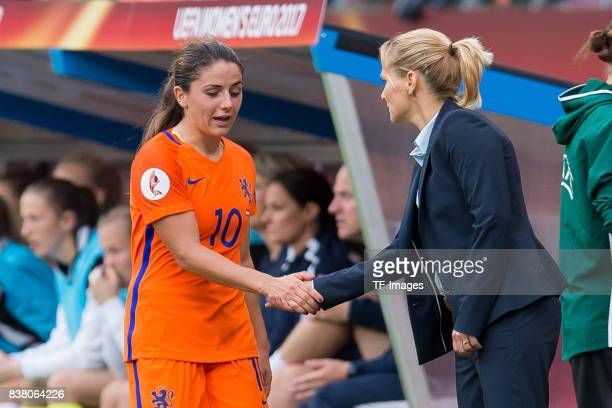 Danielle van de Donk of the Netherlands shakes hands with Head coach Sarina Wiegman of the Netherlands during their Group A match between Netherlands...