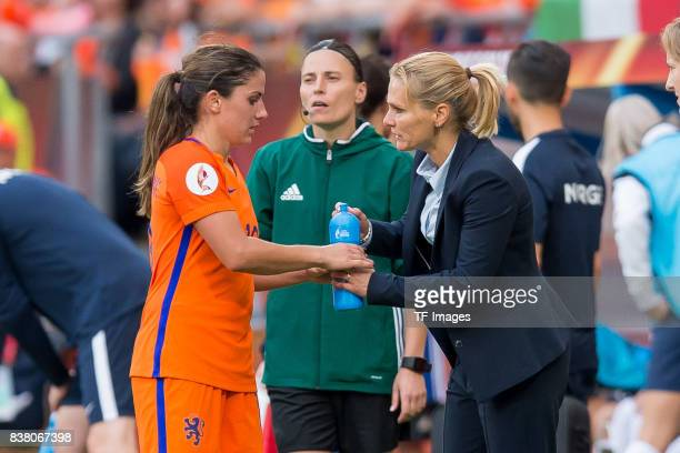 Danielle van de Donk of the Netherlands speak with Head coach Sarina Wiegman of the Netherlands during their Group A match between Netherlands and...