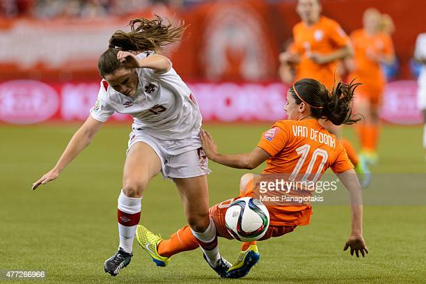 Danielle Van De Donk of the Netherlands takes down Allysha Chapman of Canada during the 2015 FIFA Women's World Cup Group A match at Olympic Stadium...