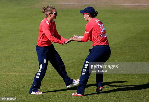 Danielle Wyatt and Georgia Elwiss of England celebrate the wicket of Nain Abidi of Pakistan during the 1st Natwest International T20 played between...