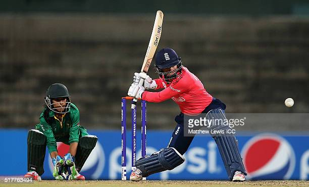 Danielle Wyatt of England hits the ball towards the bounadry as Sidra Nawaz of Pakistan looks on during the Women's ICC World Twenty20 India 2016...