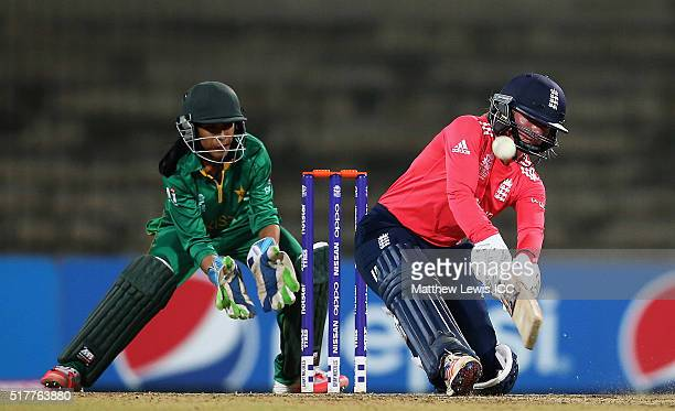 Danielle Wyatt of England plays a reverse sweep shot as Sidra Nawaz of Pakistan looks on during the Women's ICC World Twenty20 India 2016 match...