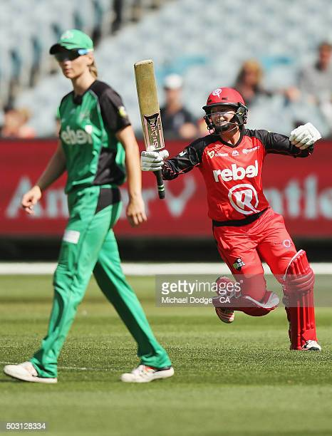 Danielle Wyatt of the Renegades celebrates hitting the winning runs next to Meg Lanning of the Stars during the Women's Big Bash League match between...