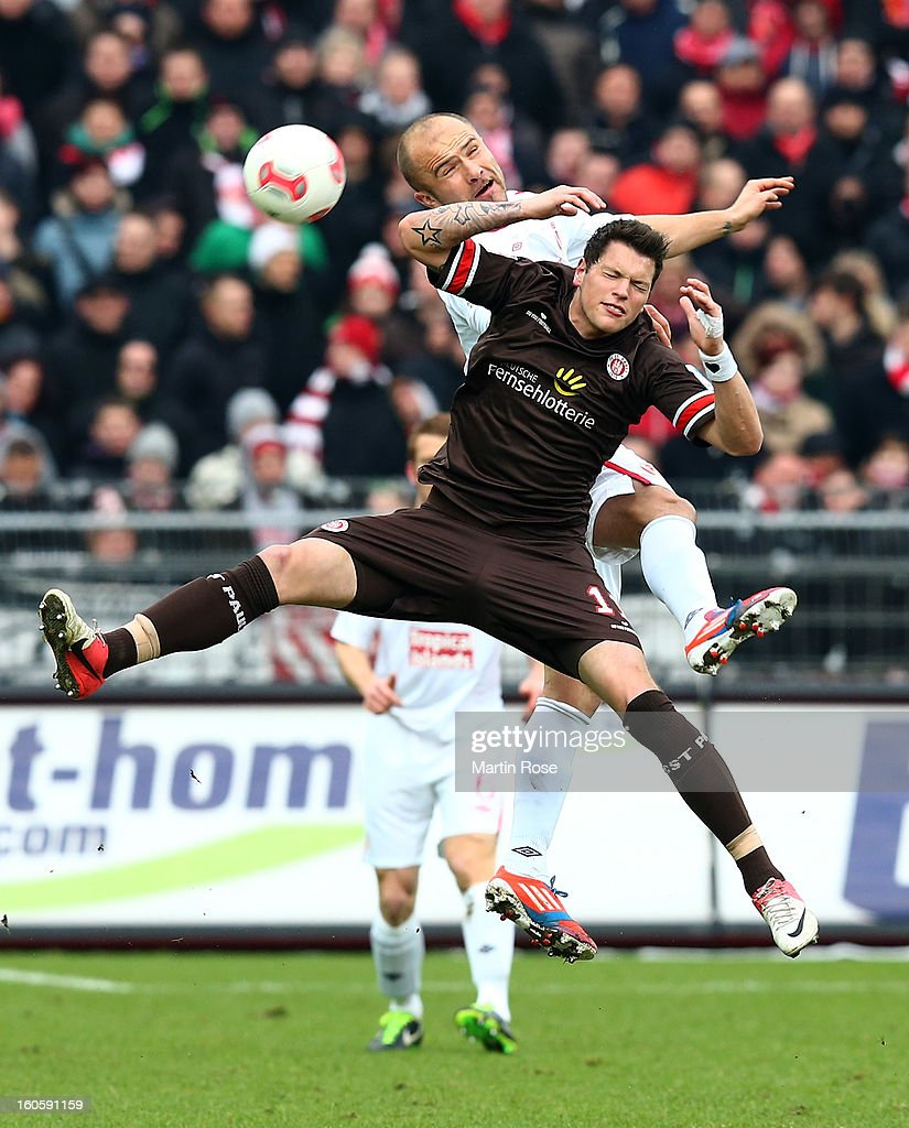 Danier Ginczek (front) of St. Pauli and <a gi-track='captionPersonalityLinkClicked' href=/galleries/search?phrase=Ivica+Banovic&family=editorial&specificpeople=656258 ng-click='$event.stopPropagation()'>Ivica Banovic</a> (back) of Cottbus head for the ball during the second Bundesliga match between FC St. Pauli and Energie Cottbus at Millerntor Stadium at Millerntor Stadium on February 3, 2013 in Hamburg, Germany.
