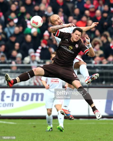 Danier Ginczek of St Pauli and Ivica Banovic of Cottbus head for the ball during the second Bundesliga match between FC St Pauli and Energie Cottbus...