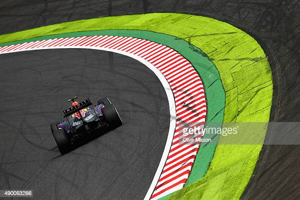 Daniil Kvyat of Russia and Infiniti Red Bull Racing drives during final practice for the Formula One Grand Prix of Japan at Suzuka Circuit on...