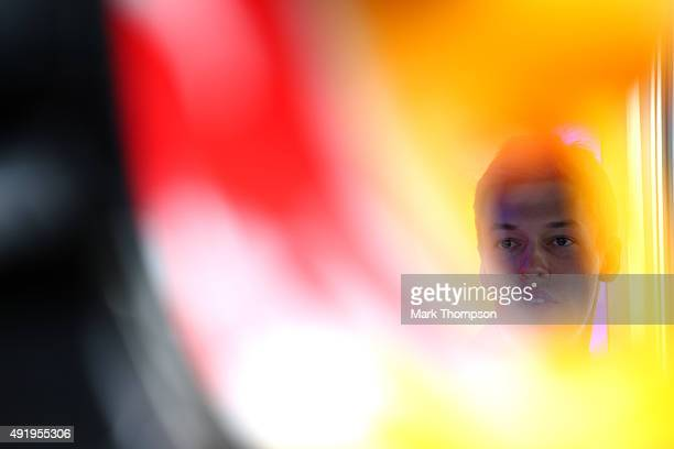Daniil Kvyat of Russia and Infiniti Red Bull Racing looks on in the garage during practice for the Formula One Grand Prix of Russia at Sochi Autodrom...