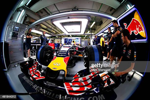 Daniil Kvyat of Russia and Infiniti Red Bull Racing sits in his car in the garage during practice for the Formula One Grand Prix of Russia at Sochi...