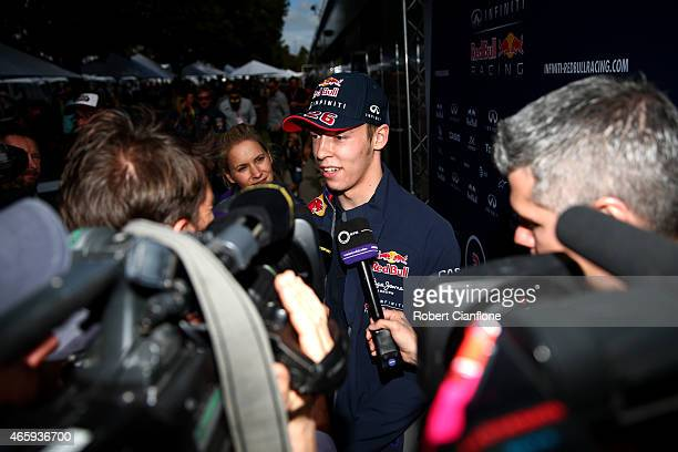Daniil Kvyat of Russia and Infiniti Red Bull Racing speaks with members of the media in the paddock during previews to the Australian Formula One...