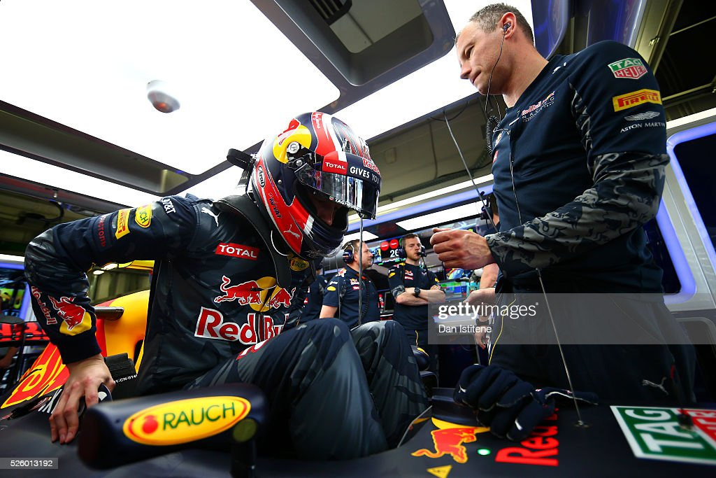 <a gi-track='captionPersonalityLinkClicked' href=/galleries/search?phrase=Daniil+Kvyat&family=editorial&specificpeople=10936016 ng-click='$event.stopPropagation()'>Daniil Kvyat</a> of Russia and Red Bull Racing climbs into his Red Bull Racing Red Bull-TAG Heuer RB12 TAG Heuer in the garage during practice for the Formula One Grand Prix of Russia at Sochi Autodrom on April 29, 2016 in Sochi, Russia.