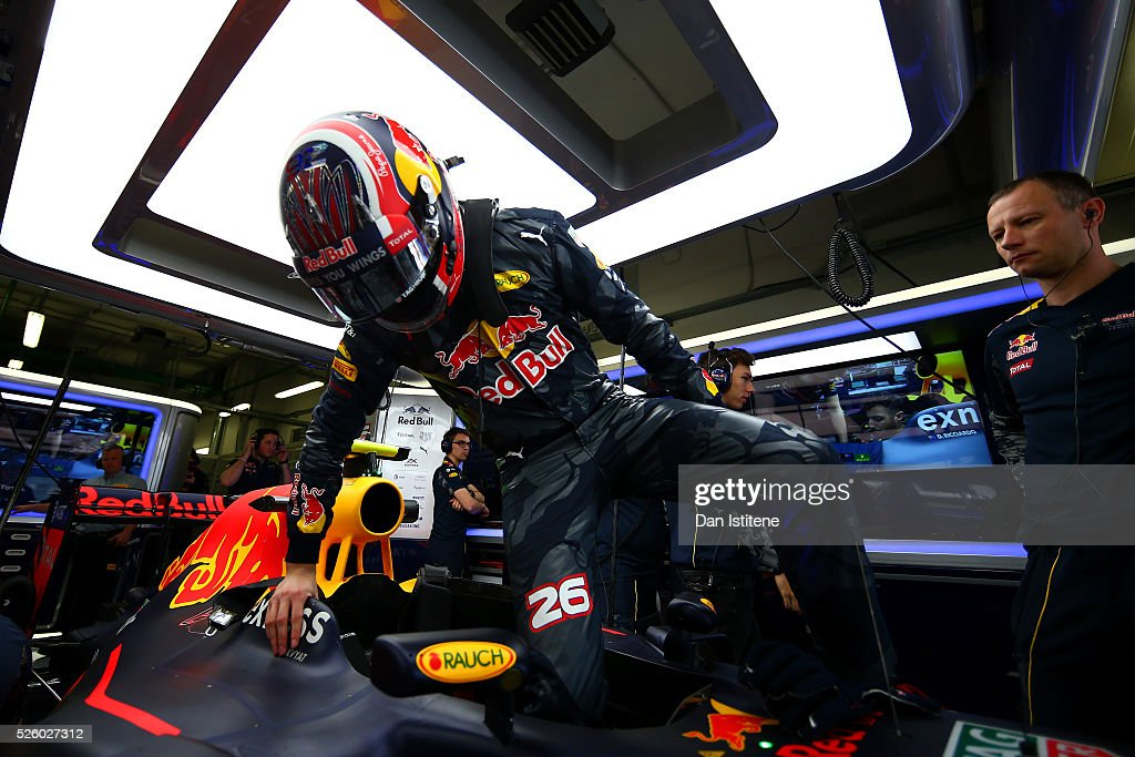 Daniil Kvyat of Russia and Red Bull Racing gets into his car in the garage during practice for the Formula One Grand Prix of Russia at Sochi Autodrom on April 29, 2016 in Sochi, Russia.