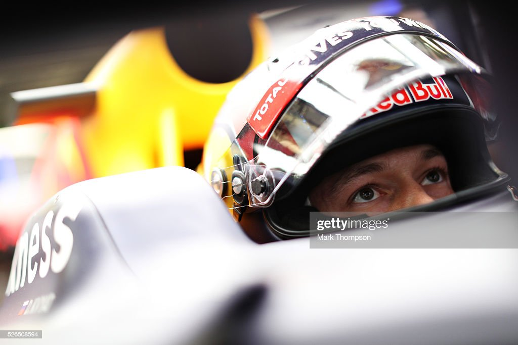 Daniil Kvyat of Russia and Red Bull Racing sits in his car in the garage during qualifying for the Formula One Grand Prix of Russia at Sochi Autodrom on April 30, 2016 in Sochi, Russia.