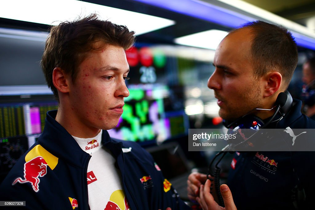 Daniil Kvyat of Russia and Red Bull Racing talks to his engineer in the garage during practice for the Formula One Grand Prix of Russia at Sochi Autodrom on April 29, 2016 in Sochi, Russia.