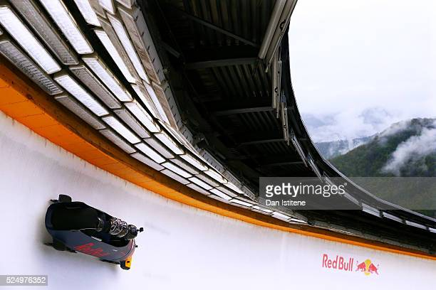 Daniil Kvyat of Russia and Red Bull Racing's personal trainer Pyry Salmela and Simon Lazenby of Sky Sports ride in a bobsleigh during previews to the...