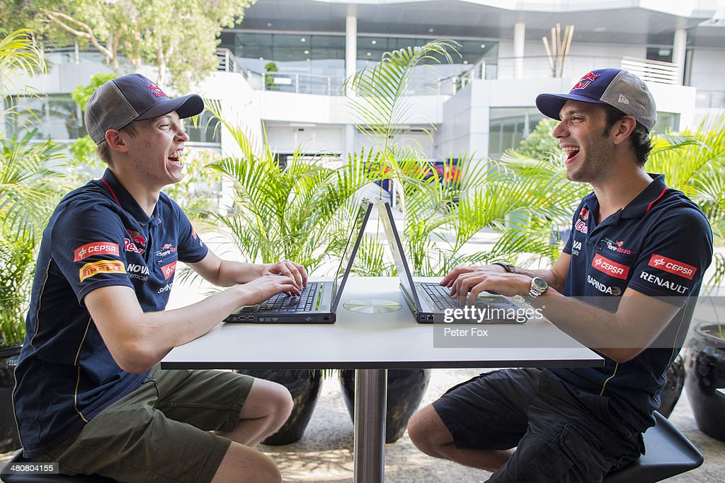 Daniil Kvyat of Russia and Scuderia Toro Rosso and Jean-Eric Vergne of France and Scuderia Toro Rosso talk in the paddock during previews to the Malaysia Formula One Grand Prix at the Sepang Circuit on March 27, 2014 in Kuala Lumpur, Malaysia.