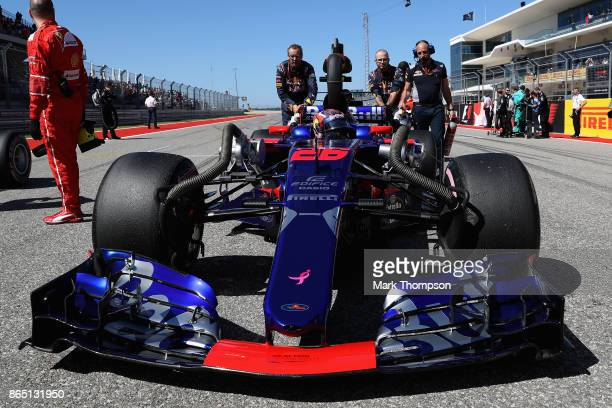 Daniil Kvyat of Russia and Scuderia Toro Rosso is pushed on the grid before the United States Formula One Grand Prix at Circuit of The Americas on...