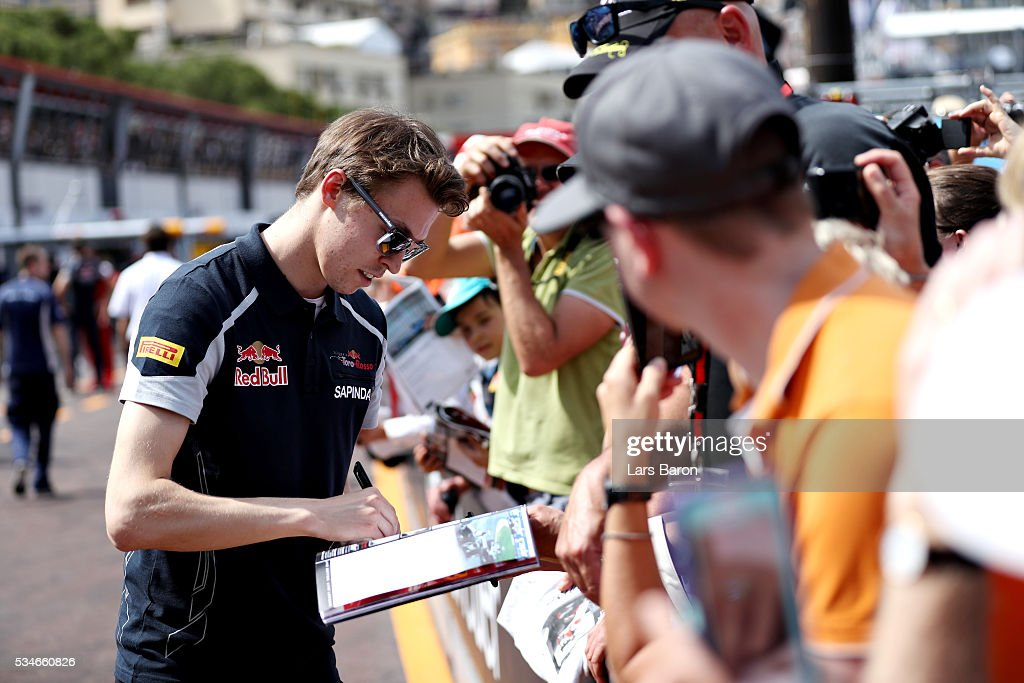 <a gi-track='captionPersonalityLinkClicked' href=/galleries/search?phrase=Daniil+Kvyat&family=editorial&specificpeople=10936016 ng-click='$event.stopPropagation()'>Daniil Kvyat</a> of Russia and Scuderia Toro Rosso signs autographs for fans during previews to the Monaco Formula One Grand Prix at Circuit de Monaco on May 27, 2016 in Monte-Carlo, Monaco.