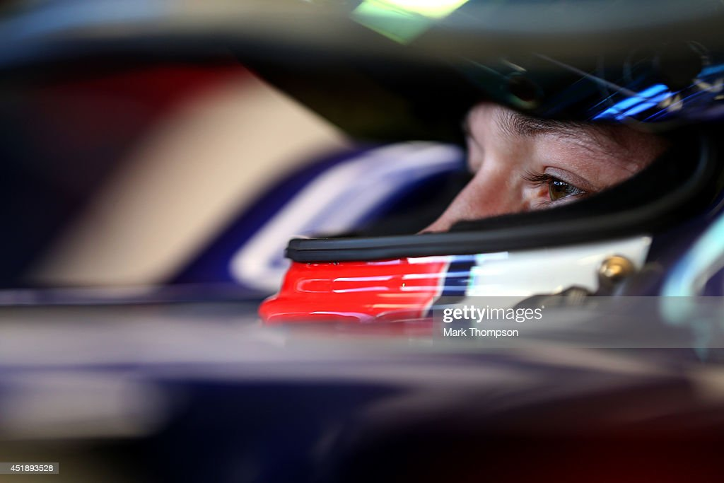 <a gi-track='captionPersonalityLinkClicked' href=/galleries/search?phrase=Daniil+Kvyat&family=editorial&specificpeople=10936016 ng-click='$event.stopPropagation()'>Daniil Kvyat</a> of Russia and Scuderia Toro Rosso sits in his car in the garage during day two of testing at Silverstone Circuit on July 9, 2014 in Northampton, England.