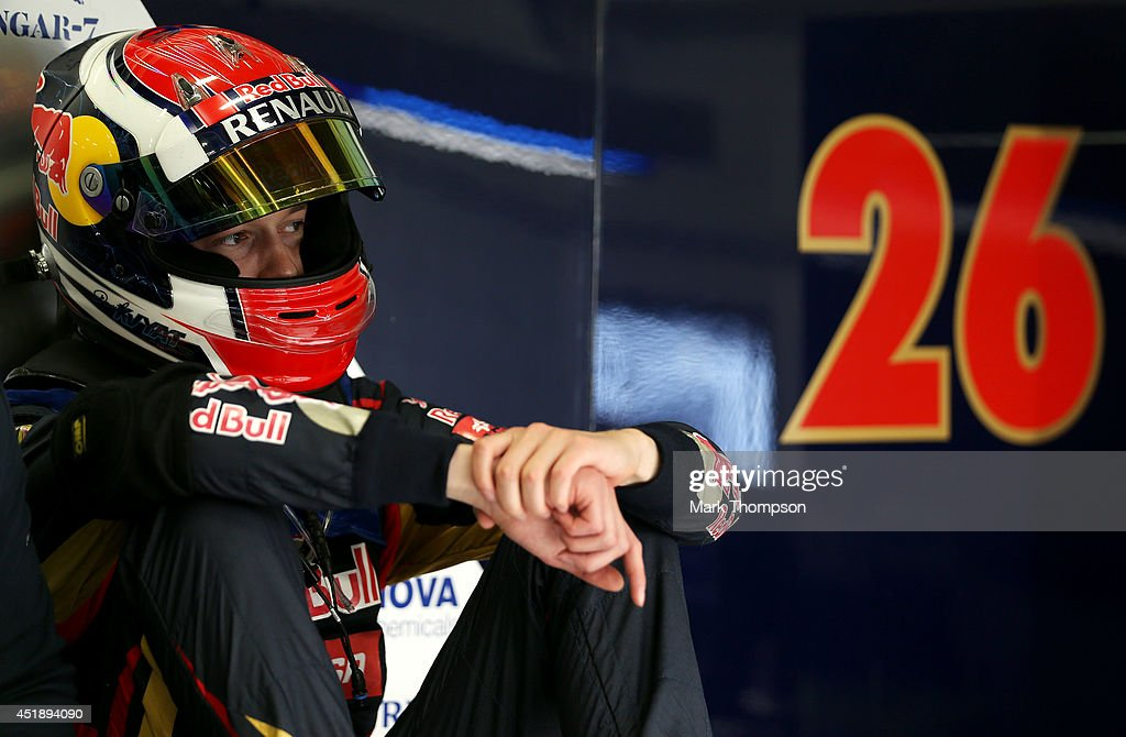 Daniil Kvyat of Russia and Scuderia Toro Rosso sits in the garage during day two of testing at Silverstone Circuit on July 9, 2014 in Northampton, England.