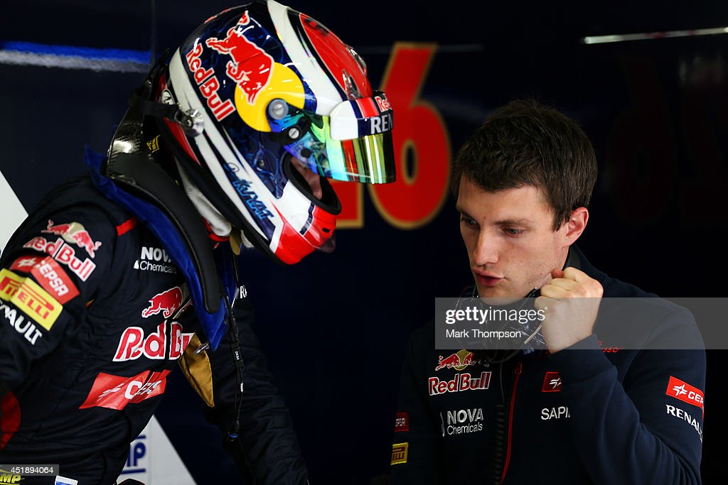 Daniil Kvyat of Russia and Scuderia Toro Rosso speaks with a member of his team in the garage during day two of testing at Silverstone Circuit on July 9, 2014 in Northampton, England.