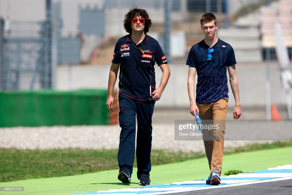 Daniil Kvyat of Russia and Scuderia Toro Rosso walks around the track with members of his team during previews ahead of the German Grand Prix at Hockenheimring on July 17, 2014 in Hockenheim, Germany.