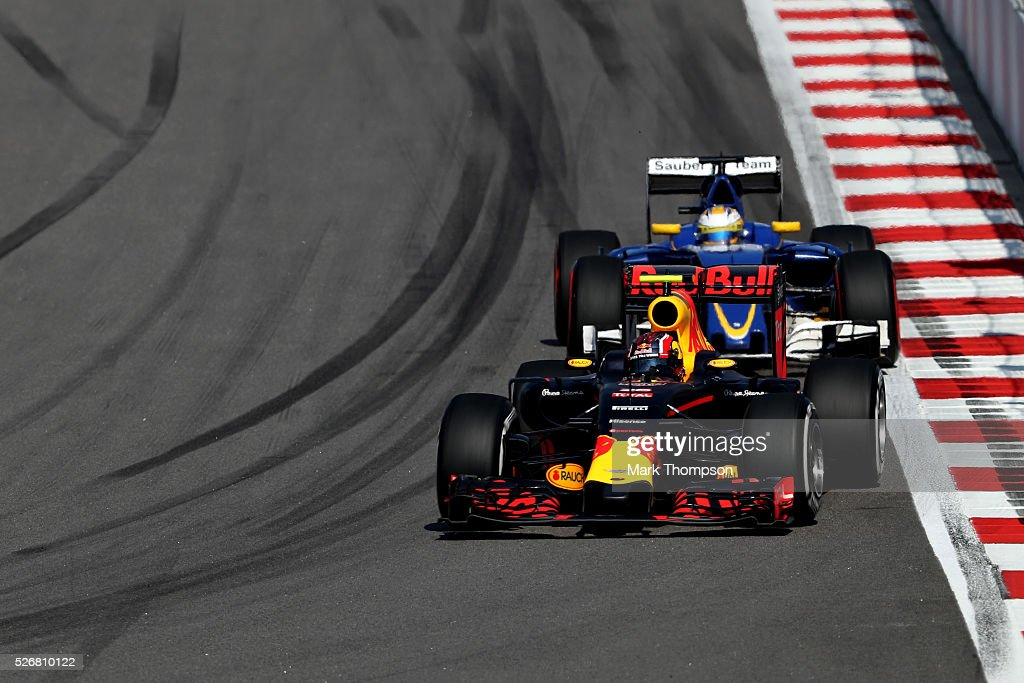 <a gi-track='captionPersonalityLinkClicked' href=/galleries/search?phrase=Daniil+Kvyat&family=editorial&specificpeople=10936016 ng-click='$event.stopPropagation()'>Daniil Kvyat</a> of Russia driving the (26) Red Bull Racing Red Bull-TAG Heuer RB12 TAG Heuer on track ahead of <a gi-track='captionPersonalityLinkClicked' href=/galleries/search?phrase=Marcus+Ericsson&family=editorial&specificpeople=6547855 ng-click='$event.stopPropagation()'>Marcus Ericsson</a> of Sweden driving the (9) Sauber F1 Team Sauber C35 Ferrari 059/5 turbo during the Formula One Grand Prix of Russia at Sochi Autodrom on May 1, 2016 in Sochi, Russia.