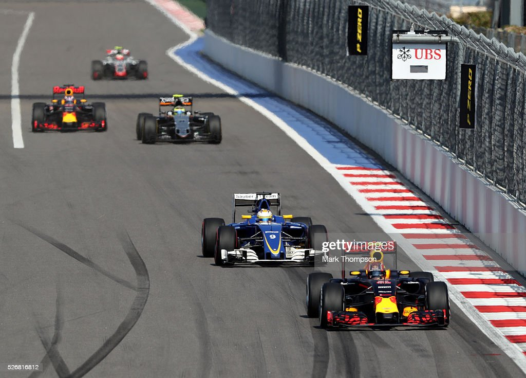 <a gi-track='captionPersonalityLinkClicked' href=/galleries/search?phrase=Daniil+Kvyat&family=editorial&specificpeople=10936016 ng-click='$event.stopPropagation()'>Daniil Kvyat</a> of Russia driving the (26) Red Bull Racing Red Bull-TAG Heuer RB12 TAG Heuer ahead of <a gi-track='captionPersonalityLinkClicked' href=/galleries/search?phrase=Marcus+Ericsson&family=editorial&specificpeople=6547855 ng-click='$event.stopPropagation()'>Marcus Ericsson</a> of Sweden driving the (9) Sauber F1 Team Sauber C35 Ferrari 059/5 turbo on track during the Formula One Grand Prix of Russia at Sochi Autodrom on May 1, 2016 in Sochi, Russia.