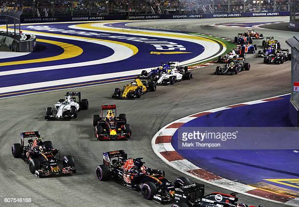 Daniil Kvyat of Russia driving the Scuderia Toro Rosso STR11 Ferrari 060/5 turbo leads Carlos Sainz of Spain driving the Scuderia Toro Rosso STR11...