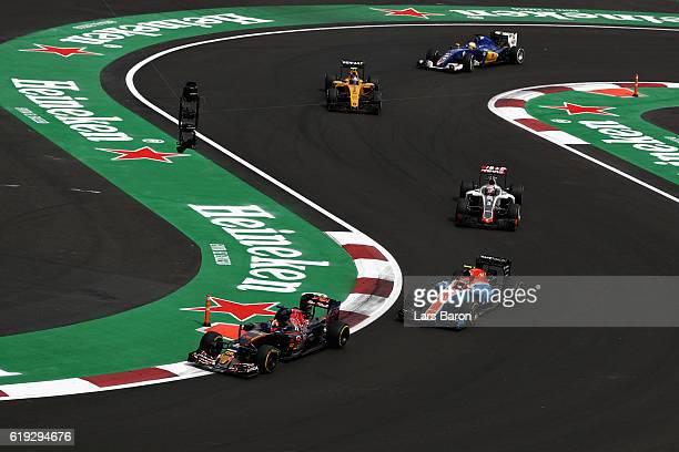 Daniil Kvyat of Russia driving the Scuderia Toro Rosso STR11 Ferrari 060/5 turbo leads a line of cars including Esteban Ocon of France driving the...