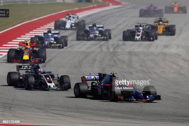 Daniil Kvyat of Russia driving the Scuderia Toro Rosso STR12 leads Romain Grosjean of France driving the Haas F1 Team HaasFerrari VF17 Ferrari on...