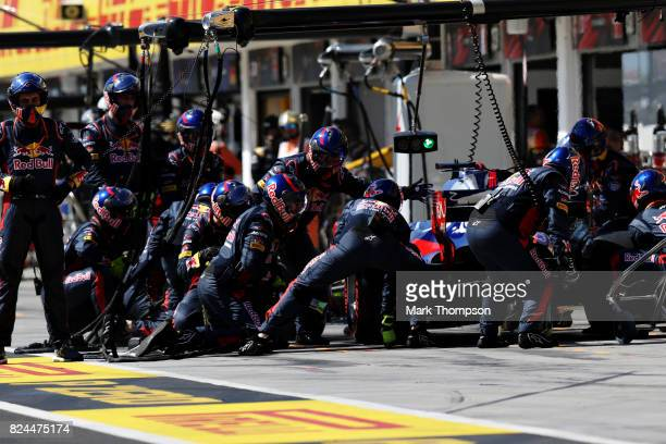 Daniil Kvyat of Russia driving the Scuderia Toro Rosso STR12 makes a pit stop for new tyres during the Formula One Grand Prix of Hungary at...