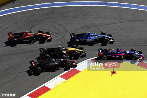 Daniil Kvyat of Russia driving the Scuderia Toro Rosso STR12 Pascal Wehrlein of Germany driving the Sauber F1 Team Sauber C36 Ferrari Jolyon Palmer...