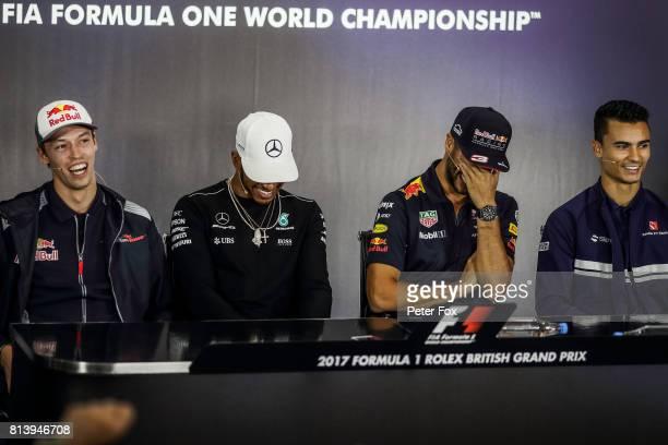 Daniil Kvyat of Scuderia Toro Rosso and Russia Lewis Hamilton of Mercedes and Great Britain Daniel Ricciardo of Australia and Red Bull Racing Pascal...