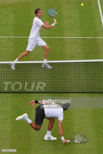 Daniil Medvedev of Russia and Novak Djokovic of Serbia in action during their semi final on Day 6 of the Aegon International Eastbourne tournament at...