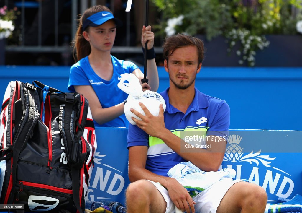 Daniil Medvedev of Russia holds an ice pack over his injury during the mens singles quarter final match against Grigor Dimitrov of Bulgaria on day five of the 2017 Aegon Championships at Queens Club on June 23, 2017 in London, England.