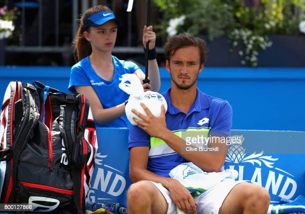 Daniil Medvedev of Russia holds an ice pack over his injury during the mens singles quarter final match against Grigor Dimitrov of Bulgaria on day...