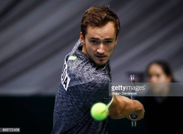 Daniil Medvedev of Russia returns the ball to Novak Djokovic of Serbia during the Davis Cup World Group first round single match between Serbia and...