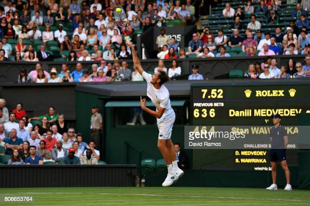 Daniil Medvedev of Russia serves during the Gentlemen's Singles first round match against Stan Wawrinka of Suitzerland on day one of the Wimbledon...
