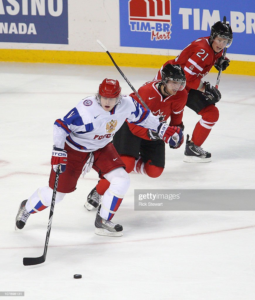 Daniil Sobchenko #14 of Russia skates against Sean Couturier #7 and Cody Eakin #21 of Canada during the 2011 IIHF World U20 Championship Gold medal game between Canada and Russia at the HSBC Arena on January 5, 2011 in Buffalo, New York.