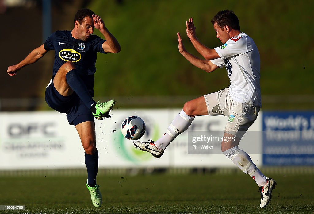 Danijel Koprivcic of Auckland (L) and Chad Coombes of Waitakere (R) contest the ball during the OFC Champions League Final match between Auckland and Waitakere at Mt Smart Stadium on May 19, 2013 in Auckland, New Zealand.
