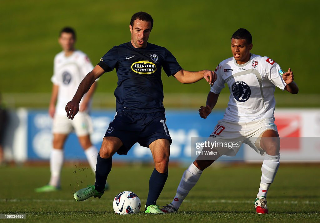 Danijel Koprivcic of Auckland (L) is put under pressure from Ryan De Vries of Waitakere (R) during the OFC Champions League Final match between Auckland and Waitakere at Mt Smart Stadium on May 19, 2013 in Auckland, New Zealand.