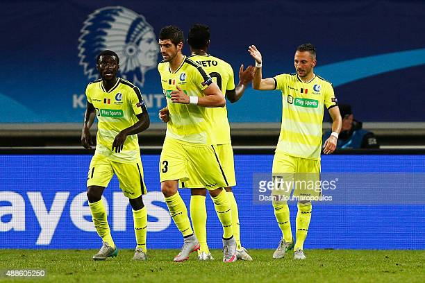 Danijel Milicevic of Gent celebrates scoring his teams first goal of the game with team mates during the UEFA Champions League Group H match between...