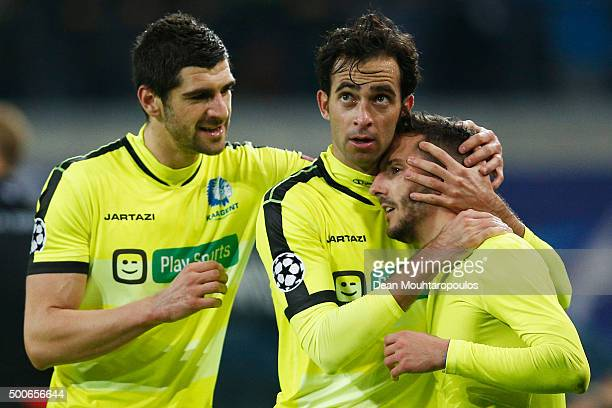 Danijel Milicevic of Gent celebrates scoring his teams second goal of the game with team mates during the group H UEFA Champions League match between...
