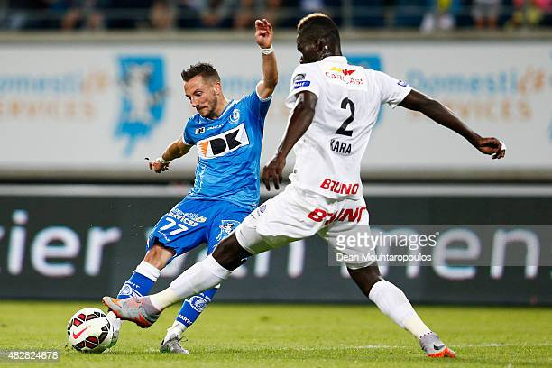 Danijel Milicevic of Gent shoots on goal during the Jupiler League match between KAA Gent and KRC Genk held at the Ghelamco Arena on July 31 2015 in...
