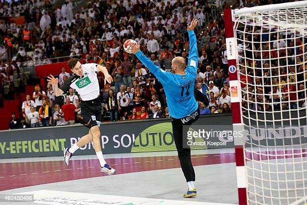 Danijel Saric of Qatar saves a shot of Patrick Groetzki of Germany during the quarter final match between Qatar and Germany at Lusail Multipurpose...
