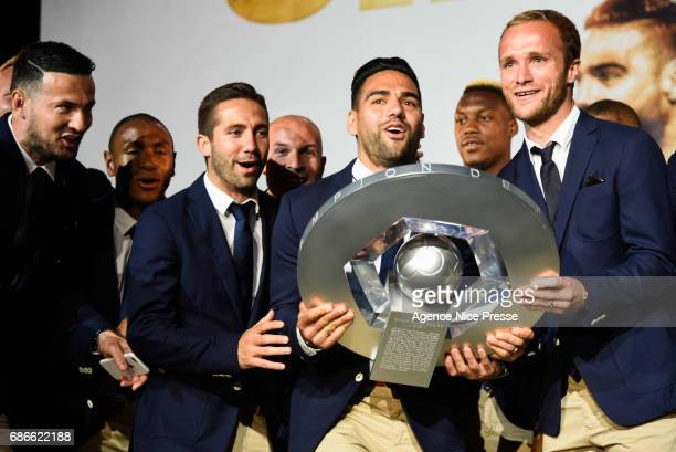 Danijel Subasic Joao Moutinho Valere Germain and Radamel Falcao of Monaco with the trophy during AS Monaco French Ligue 1 Winners Parade on May 21...