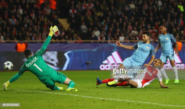 Danijel Subasic of AS Monaco makes a save from Sergio Aguero of Manchester City as Fabinho of AS Monaco challenges during the UEFA Champions League...